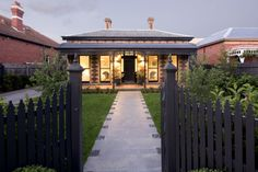 This is a two-storey extension which interfaces with an existing single storey Victorian brick villa within Malvern's heritage listed neighbourhood.