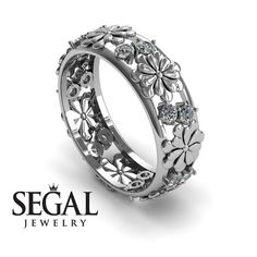 Whether you're celebrating your first anniversary or your 50th, your wife is going to love our Aria Anniversary ring. This gorgeous and comfortable Diamond ring is set in solid 14K White Gold and Flowers all around the band. With a popular Antique Ring style, this ring is adorned with 14