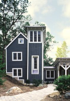 Contemporary farmhouse style residence with silo-inspired tower.