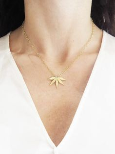 Cathy Waterman Jewelry - Passion Flower Necklace    Handcrafted in 22-karat yellow gold.  Detailed in white diamond.  Diamonds total 0.02 carats.  Pendant measures 1-in. across.  Necklace measures 16-in. long.  Finished with a toggle clasp.