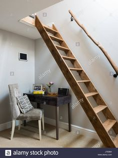 Stock Photo - Study with wooden ladder and rustic hand rail to loft space Tiled Staircase, Loft Staircase, Wooden Staircases, House Stairs, Loft Railing, Wooden Ladder, Attic Remodel, Interior Stairs, Attic Spaces