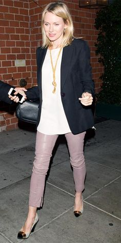 Look of the Day › February 2, 2014 WHAT SHE WORE Spotted out in Beverly Hills Naomi Watts hung out with friends in a sharp black blazer paired with a white top and pastel leather pants, elevating her look even further with a gold knot necklace and metallic two-toned pumps.
