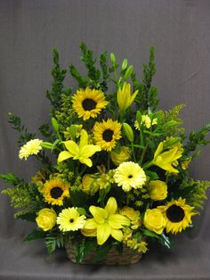 Beautiful altar arrangement with sunfowers, gerbera daisies, lilies and yellow roses. A wonderful remembrance.