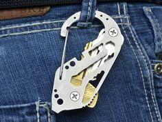 The KeyBiner by Fortius Arms out of Erie, PA puts together many useful EDC ideas into one compact package. At its heart, it's a carabiner bolstered with tools like a bottle opener, wrench slots and a stepped prybar/screwdriver. The KeyBiner's secret, however, is the use of screws and hardware to add a key management system on its rear. It accommodates up to 14 keys or compatible tools like a USB flash drive. There's plenty of time left to pledge for your own KeyBiner in your choice of…