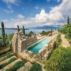 On a Croatian island in the Adriatic Sea, architect Antonio Zaninovic, designer Lucien Rees Roberts, and landscape architect David Kelly repurposed ruins into a contemporary retreat complete with pool. Photography by Scott Frances, courtesy of Otto. Dream Pools, Interior Design Magazine, Stone Houses, Garden Pool, Cool Pools, Pool Designs, Jacuzzi, Water Features, Landscape Design