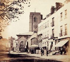 Chelsea Old Church on the corner of Old Church Street and the Embankment,1860s. ~ The church was painstakingly rebuilt after a parachute landmine blew the tower over onto the church, destroying most of it, in the Blitz in April 1941. For nine years the congregation carried on  in a ward of the adjoining hospital. From 1950 onward the church was reopened bit by bit and  reconsecrated in May 1958 by the Lord Bishop of London in the presence of the Queen Mother