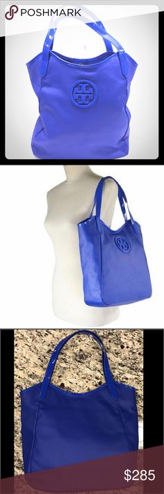"""Tory Burch Tote Tory Burch Dipped Canvas Stacked Logo Tote in blue.  Coated canvas with patent leather trim.  Approx 12"""" x 13"""" x 5"""". Double straps with 7.5"""" strap drop.  Magnetic snap closure.  Interior zip pocket and 2 slip pockets.  Fabric lining, gold tone hardware. Large TB logo on front, gold TB logo inside. Emblem inside still has protective film over it.  Perfect condition.   Absolutely no signs of wear. Tory Burch Bags Totes"""
