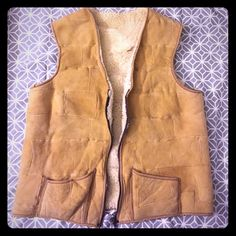 Vintage 70's Shearling Vest Vintage 70's patchwork genuine Shearling Vest, very very soft. This is true vintage and in vintage condition; a few spots of the inner wool have worn away (not much at all) and the zipper zips not quite all the way up (but almost!). Otherwise it's quite beautiful and definitely wearable.  It was originally designed for a man but a lady could certainly wear it. There are no tags. The widest part of the chest (while zipped) is 21 inches (flat) and it is 25 inches…