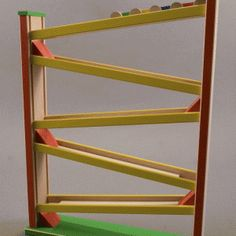 """The """"Toboggan Train Racer"""" is So Much Fun  for Your Child.  Watch the Brightly Colored Cars Race Their Way from the Top to the Bottom of the Tower."""
