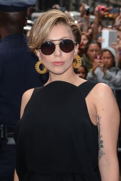 This short brunette crop with blond highlights just might be her real hair . . .