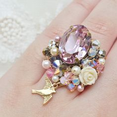 Purple Gem Statement Ring - romantic jewelry - lilac swarovski gem cabochon, white coral rose cabochon, crystals & goldtone bird charm. $30.00, via Etsy.