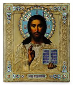 A Silver-Gilt and Cloisonné Enamel Icon of Christ Pantocrator -  Maker's mark and town mark indistinct, 1899-1908 -  Rectangular, Christ realistically painted, raising his right hand in benediction & holding the Gospels in his left hand, his silver-gilt vestments repoussé & chased with geometric borders, the oklad cloisonné enamelled in turquoise with vari-colour enamelled scroll accents & translucent red lettering & highlighting,  12.5 x 10 5/8 in.