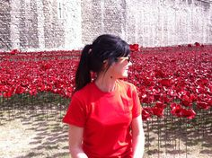 "Hannah Kokoschka's sister Emma D'Arcey planting poppies at the Tower of London August 2014 as part of Paul Cummins amazing installation ""Blood Swept Land and Seas of Red."""
