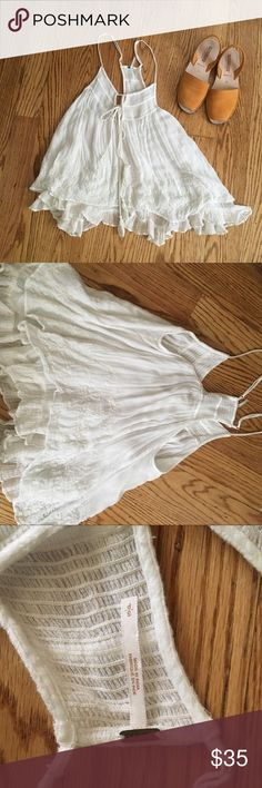 Free People gauzy tank Free people flowing tank top with adjustable straps and embroidered eyelet detail. Double layered sheer gauze top. One tassel is missing. Free People Tops Tank Tops
