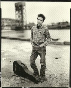 Okay, so this is the coolest Dylan photo I have ever seen.  I mean, he is wearing plaid and jeans.  This screams Minnesota.  Furthermore, the fricken Duluth Lift Bridge is in the background.