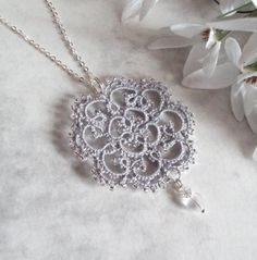 "deviantART: Lace tatted pendant ""Rosetta"" by TataniaRosa  pattern link is here on deviantArt."