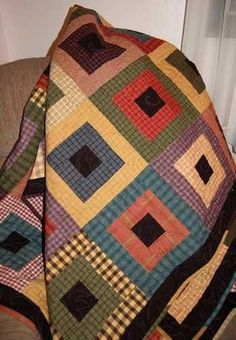 Stepping Stones, this is a link to buy the pattern. She has made it entirely with plaids, but this could be a good stash-buster !!!: