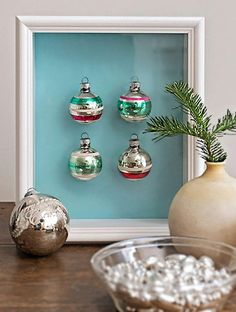 Add a dose of Christmas cheer to other rooms in your home with small picture frames and a collection of colourful baubles