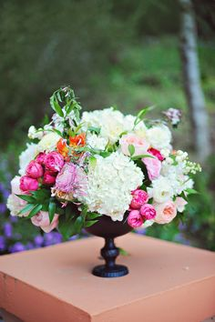 Love the shape of this container #flowers #centerpiece #wedding :: ArinaB Photography