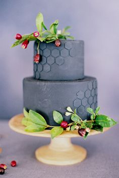 Dark, modern cakes can be entirely wedding worthy. Nine Cakes amped up the style on this two-tiered confection with textural honeycomb accents.