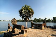 Srah Srang is a temple by the water where only scarce ruins remain. The sunrise and sunset views are worth the visit. Angkor Wat, Temples, Cambodia, Mount Rushmore, Sunrise, To Go, Explore, Adventure, Mountains