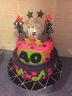 "70's theme electric colored disco cake. Chocolate bottom 12"" with purple Choc buttercream and 8"" top tier vanilla sponge with pink vanilla buttercream. Decorated with handmade fondant toppers, stars and disco dancers. By Natalie Baxter https://m.facebook.com/Cake-Me-Smile-by-Natalie-965591876858656/"