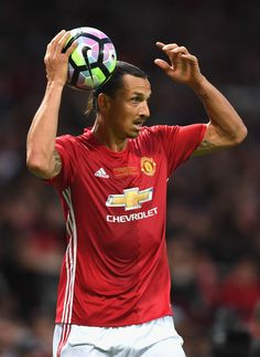 Zlatan Ibrahimovic Photos - Zlatan Ibrahimovic of Manchester United takes a throw in during the Wayne Rooney Testimonial match between Manchester United and Everton at Old Trafford on August 3, 2016 in Manchester, England. - Wayne Rooney Testimonial: Manchester United v Everton