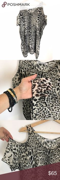 "Lovers + Friends animal print Weekend Tunic Sexy and super flattering, Size Medium. Sheer fabric. Featuring cold shoulder design cut out sleeves.Measures 31"" Long and 22"" wide approximately. Wear it as a mini dress or with skinny jeans, even as a beach cover-up! In like new condition. Price firm. Not taking offers on this one 🤘🏼 Tops Tunics"