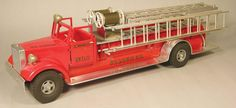 "Smith-Miller Toy Truck, St. Louis Fire Dept Engine Co. No.7 Mack Fire Ladder Truck. Fred Thompson production ""0044/100"". Excellent condition. 25 inches long."