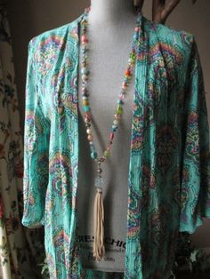 Colorful knotted leather tassel necklace by slashKnots on Etsy