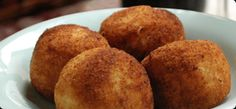 """There's no such thing as """"leftover risotto"""" in my house, so I have to make a batch ahead of time just for arancini. Besides mozzarella, I've also stuffed these with pancetta cubes, marinated peppers and whole roasted garlic cloves."""