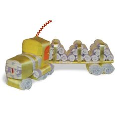 "Log Truck (Diaper Cake). Instead of diapers as the ""load"" have a box shape of something... Like wipes or a toy in a display box...etc"