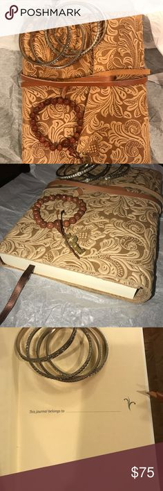 A dazzling gift Set Italian Leather journal and... A dazzling gift set! An authentic Italian Leather journal with a sparkling handmade heavy beaded bracelet to go with the journal theme (key on the bracelet) and a matching trio of three illuminating rhinestone bengal bracelets. Wrapped in a bow. Two pages missing from journal because they were accidentally bent while closing the journal. Other