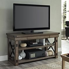 """Features: -Open shelves hold AV components. -Black metal side frames. -Finish: Rustic Gray. -1 Year warranty. TV Size Accommodated: -48"""". Product Type: -TV Stand. Design: -Open shelving. Finis https://emfurn.com"""
