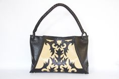 Leather brown and cream Abbe bag. I especially love this one because she's unlike any other AL bags. Such a fun design!