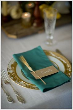 Rustic and Refined: Sprigs of wheat tucked into craft paper place cards. Complement to the gold trimmed dinnerware.