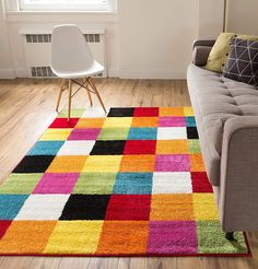"""Bright, bold, and fun, the multi-color checkerboard boxes of this rug are sure to delight kids and adults alike. Besides its soft 0.4"""" pile, clean design, and vivid colors, this rug is stain and fade resistant and super easy to clean. Its edges are bound with serging for enhanced durability and its 100% jute backing is wood floor safe. All this making for the perfect well-wearing rug for the active home. We recommend use anywhere from bedrooms and playrooms to nurseries and classrooms. Soft 0.4"""" Kids Area Rugs, 8x10 Area Rugs, Modern Kids, Modern Contemporary, Bedroom Carpet, Online Home Decor Stores, Online Shopping, Dorm Decorations, Room Rugs"""