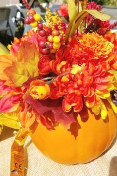 Blow your guest away with one of these eye-catching pumpkin vase centerpieces full of flowers. They are so impressive and will so elegantly decorate a table. See more party ideas and share yours at CatchMyParty.com Pumpkin Cake Pops, Pumpkin Vase, Pumpkin Centerpieces, Party Centerpieces, Pumpkin 1st Birthdays, Thanksgiving Parties, Baby In Pumpkin, Painted Pumpkins, Autumn Theme