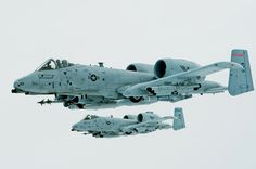 Close air support First Lt. Micha Stoddard, flying the lead aircraft, and his wingman, Capt. Casey Peasley, fly their A-10 Thunderbolt IIs ...