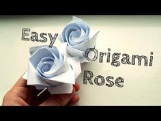 Learn how to make an easy origami rose with this video tutorial. Easy Origami Rose, Instruções Origami, Design Origami, Origami Artist, Origami And Kirigami, Money Origami, Origami Butterfly, Origami Flowers, Oragami
