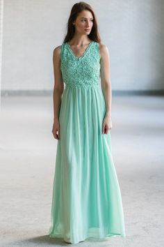 This lace and chiffon maxi dress is the perfect option for brides or bridesmaids--or just to pack on your next vacation! It looks great dressed down with beaded sandals and a boho headband or dressed up with strappy heels or wedges. The Dimiana Lace and Chiffon Maxi Dress is fully lined. It has a V neckline, wide shoulder straps, an empire waist, and a full length maxi skirt. The top of this dress is made of lace with a floral pattern on it. The back of this dress has an open back design…