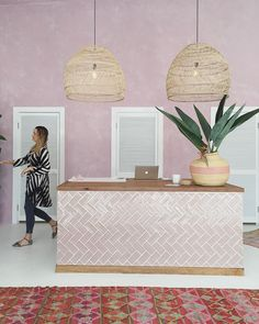 playful reception desk with glossy pink subway tile