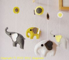 This elephant mobile is so cute- it makes it impossible for you to forget how to smile.  Baby Mobile  by hingmade, $90.00