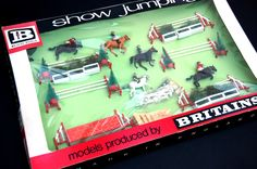 """Vintage Toys Wanted by the-toy-exchange - A stunning example of a rare old shop stock No.7594 BRITAINS MODELS 'SHOW JUMPING' box display set. Measures 22"""" x 14"""" x 2"""" and contains fences, jumps, horses, riders plus other parts."""