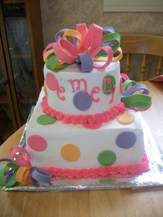 A colorful birthday cake for a little girl.