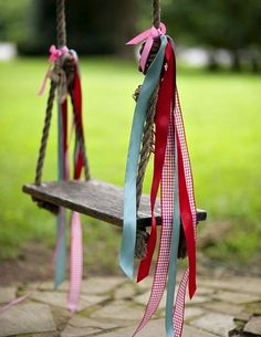 SWING - A swing is a hanging seat, usually found at playgrounds for children or on a porch for relaxing