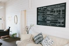 Vintage Treasures in a Historic 1890s Australian Country Cottage: love the pillows and art