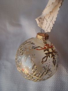 Snowflake Glass Christmas Ball Ornament with by VintageBeth - pretty, and makes me want to make hanging snowflakes out of newsprint
