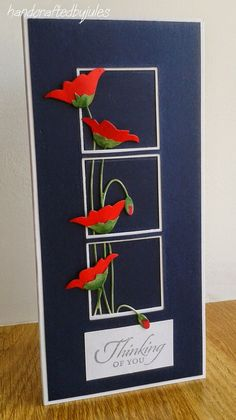 handmade card Crafted by Jules: Prim Poppy ... tall and thin format .. navy blue with with mats ... die cut poppies in bright red and green behind and coming out of three square windows ... great card!