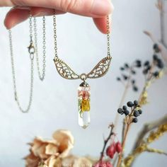 Crystal necklace forest lichen moss terrarium dried flowers resin jewelry herbarium botanical jewelry crystal pendant forest potal wings by sincereworkshop on Etsy